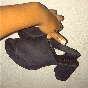Black suede platform clogs